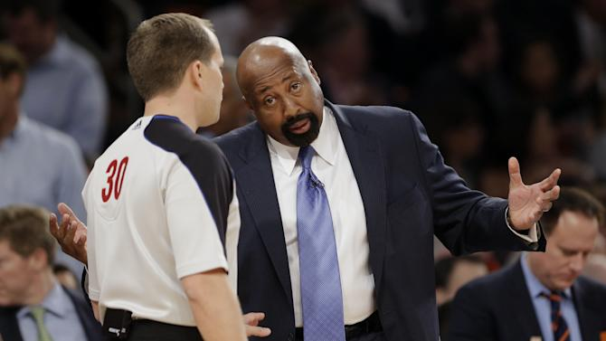 New York Knicks coach Mike Woodson, right, talks to referee John Goble in the first half of Game 5 of an Eastern Conference semifinal in the NBA basketball playoffs, at Madison Square Garden in New York, Thursday, May 16, 2013. (AP Photo/Julio Cortez)