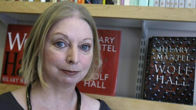"""FILE - In this Thursday, Oct. 8, 2009 file photo, the  winner of the 2009 Booker Prize for fiction Hilary Mantel with her book  """" Wolf Hall """" poses for  a photograph following an interview  in London. British writer Hilary Mantel was named one of six finalists for the prestigious Booker literary prize on Tuesday, Sept. 11, 2012 for """"Bring up the Bodies,"""" a tale of politics and passion at the court of King Henry VIII. (AP Photo/Alastair Grant, File)"""