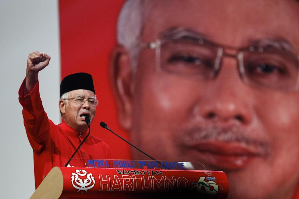 FILE- In this May 11, 2015 file photo, Malaysian Prime Minister Najib Razak addresses delegates during his speech at the Malaysia's ruling party...