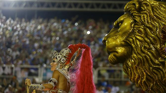 A reveller of the Salgueiro samba school performs during the carnival parade at the Sambadrome in Rio de Janeiro