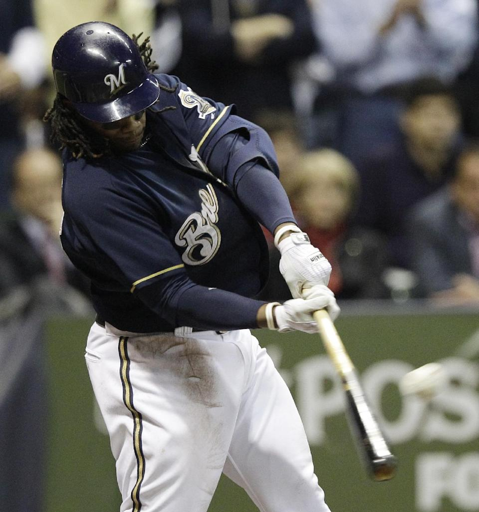 Milwaukee Brewers' Rickie Weeks hits a two-run home run during the fourth inning of Game 2 of baseball's National League championship series against the St. Louis Cardinals Monday, Oct. 10, 2011, in Milwaukee. (AP Photo/David J. Phillip)