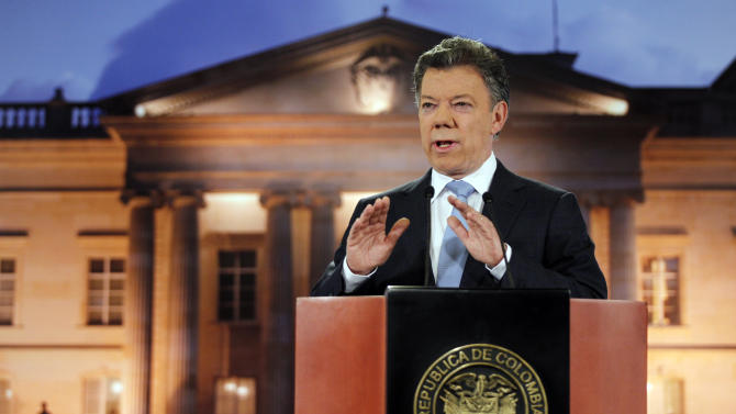 Colombia's President Juan Manuel Santos delivers a speech during a televised address to the nation at the presidential palace in Bogota, Colombia, Monday, Aug. 27, 2012. Santos said his government has held exploratory talks with rebels of the the leftist Revolutionary Armed Forces of Colombia, FARC. (AP Photo/Fernando Vergara)