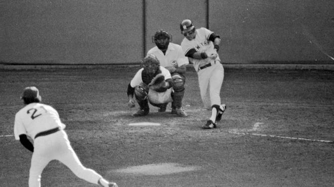 FILE - In this Oct. 2, 1978, file photo, New York Yankees' Bucky Dent hits a three-run home run against the Boston Red Sox during the seventh inning of a baseball game for the American League East title in Boston. It was only Dent's fifth home run of the season, but it put New York ahead 3-2, and they never trailed again. The Yankees won 5-4. The Associated Press takes a look at the nine one-game playoffs in major league history. (AP Photo/Ray Stubblebine, File)