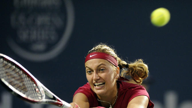 Petra Kvitova, of the Czech Republic, stretches for a backhand during a semifinal against Samantha Stosur, of Australia, at the Connecticut Open tennis tournament in New Haven, Conn., on Friday, Aug. 22, 2014. (AP Photo/Fred Beckham)