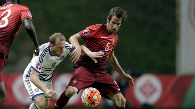 Portugal's Coentrao fights for the ball with Denmark's Krohn-Dehli during their Euro 2016 qualifying soccer match at Municipal Stadium in Braga