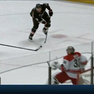Corey Perry launches the puck past Cam Ward