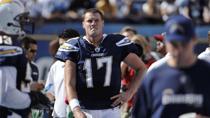 San Diego Chargers quarterback Philip Rivers walks near the bench during the second half against the New England Patriots in an NFL football game Sunday, Oct. 24, 2010, in San Diego. The Patriots won 23-20. (AP Photo/Denis Poroy)
