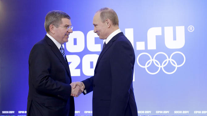 Russian President Vladimir Putin, right, greets International Olympic Committee President Thomas Bach at an event welcoming IOC members ahead of the upcoming 2014 Winter Olympics at the Rus Hotel, Tuesday, Feb. 4, 2014, in Sochi, Russia. (AP Photo/David Goldman)