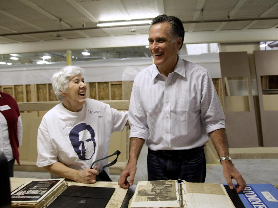 Republican presidential candidate, former Massachusetts Gov. Mitt Romney talks with Paula Huber, of Melba, Idaho who presented him with a scrapbook of photos from his father George's political career, Friday, Feb. 17, 2012, at Guerdon Enterprises in Boise, Idaho. (AP Photo/Marcio Jose Sanchez)