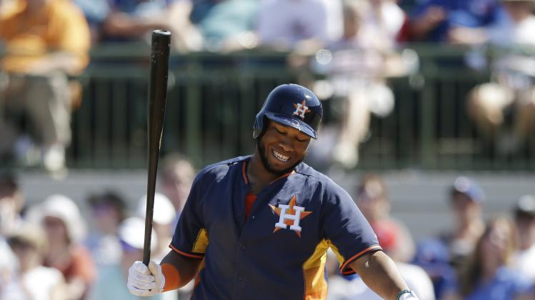 Houston Astros' Jon Singleton reacts after striking out during a spring training baseball game against the Toronto Blue Jays in Kissimmee, Fla., Sunday, March 9, 2014. (AP Photo/Carlos Osorio)