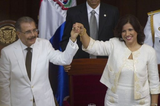 <p>Dominican Republic's president elect Danilo Medina (L) and vice president elect Margarita Cedeno de Fernandez attend their inauguration at the National Congress in Santo Domingo. The 60-year-old economist won May 2012 elections on a promise to raise the Carribean country's standard of living.</p>