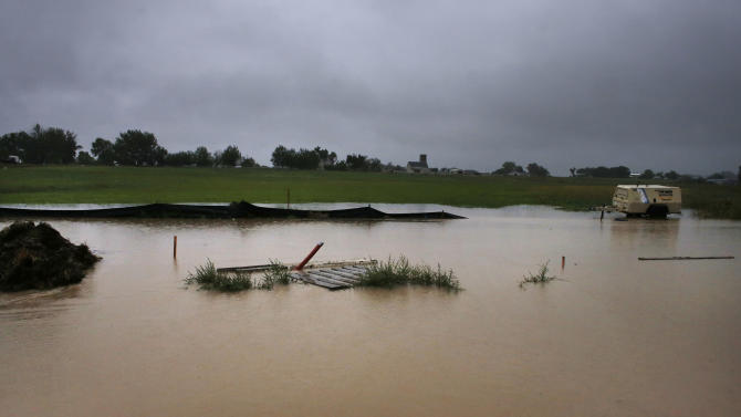 Flooded Colo. towns clean up as rescues continue