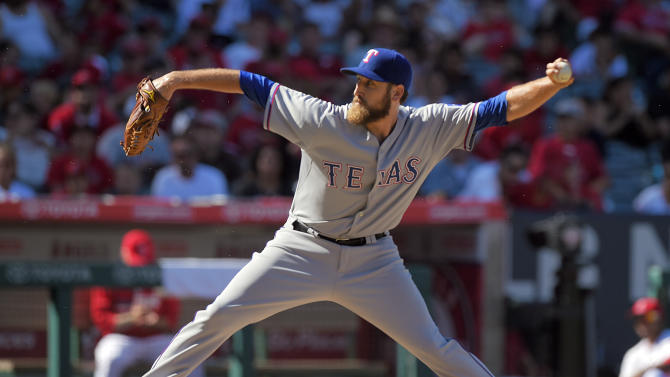 Texas Rangers reliever Michael Kirkman pitches to the Los Angeles Angels in the eighth inning of a baseball game in Anaheim, Calif., Sunday, Sept. 21, 2014. (AP Photo/Mark J. Terrill)