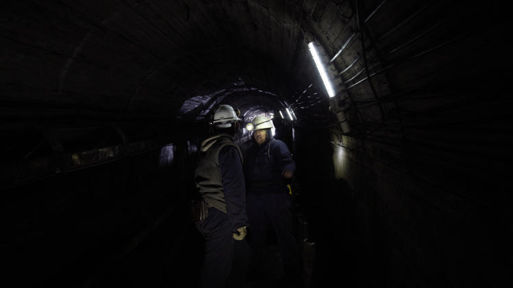Women miners Sakiba Colic, right, and Semsa Hadzo, left, Bosnian coal technologists,  ride a coal mine train during their 8-hour shift in the shaft of the mine in Breza, 20 kms north of Sarajevo, Bosnia, on Wednesday, Jan. 16, 2013. The mine in Breza is the only one in Bosnia where a group of women work deep underground in the coal mines alongside their male colleagues, a legacy of communism, but they're set to retire in three years, marking the end of an era for this community where almost everybody is connected to the coal mine. The shafts and elevators echo with laughter and tales of their grandchildren as women miners work alongside their male counterparts.(AP Photo/Amel Emric)