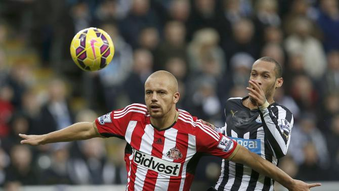 Newcastle United's Yoan Gouffran challenges Sunderland's Wes Brown during their English Premier League soccer match at St James' Park in Newcastle