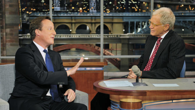 "In this photo provided by CBS, British Prime Minister David Cameron, left, talks with host David Letterman on the set of the ""Late Show with David Letterman,"" Wednesday, Sept. 26, 2012 in New York. (AP Photo/CBS, John Paul Filo) MANDATORY CREDIT; NO ARCHIVE; NO SALES"