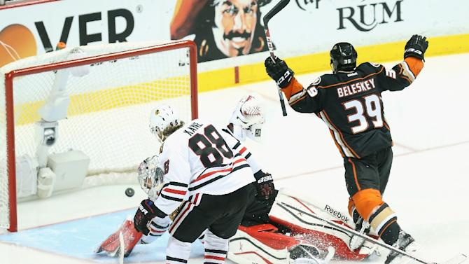 Matt Beleskey (R) of the Anaheim Ducks celebrates scoring the game-winning goal as he trips over goaltender Corey Crawford (C) of the Chicago Blackhawks during Game Five of the Western Conference Finals at Honda Center on May 25, 2015