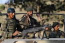 Afghan National Army soldiers arrive at the site of an attack on the outskirts of Kabul