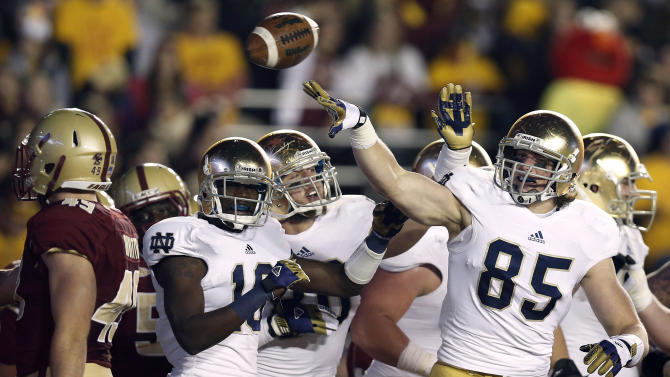 Notre Dame tight end Troy Niklas (85) celebrates with teammate after catching a touchdown pass against the Boston College during the first half of an NCAA college football game in Boston on Saturday, Nov. 10, 2012. (AP Photo/Winslow Townson)