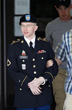 Army Pfc. Bradley Manning is escorted out of a courthouse in Fort Meade, Md., Tuesday, June 25, 2013, after the start of the fourth week of his court martial. Manning is charged with indirectly aiding the enemy by sending troves of classified material to WikiLeaks. He faces up to life in prison if convicted. (AP Photo/Jose Luis Magana)