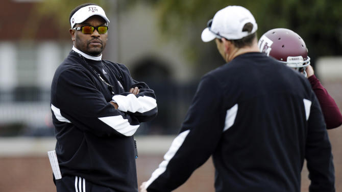Texas A&M head coach Kevin Sumlin watches practice for the Cotton Bowl NCAA college football game, Sunday, Dec. 30, 2012, in Dallas. Texas A&M is scheduled to play Oklahoma on Jan. 4, 2013. (AP Photo/LM Otero)
