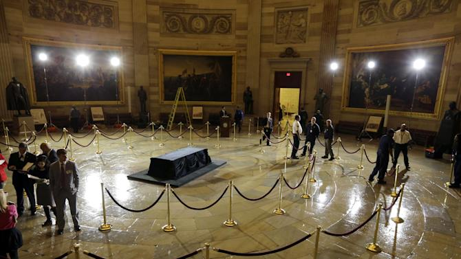 Preparations are made for Senate President Pro Tempore Daniel K. Inouye, D-Hawaii, to lie in state Thursday in the U.S. Capitol Rotunda, on Capitol Hill Wednesday, Dec. 19, 2012 in Washington. (AP Photo/Alex Brandon)