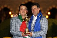 European team captain Jose Maria Olazabal (right) poses with Francesco Molinari and the Ryder Cup at Medinah Country Club in Medinah, Illinois. Olazabal has called up Molinari for December's Royal Trophy after the Italian's last-day heroics against Tiger Woods at the Ryder Cup