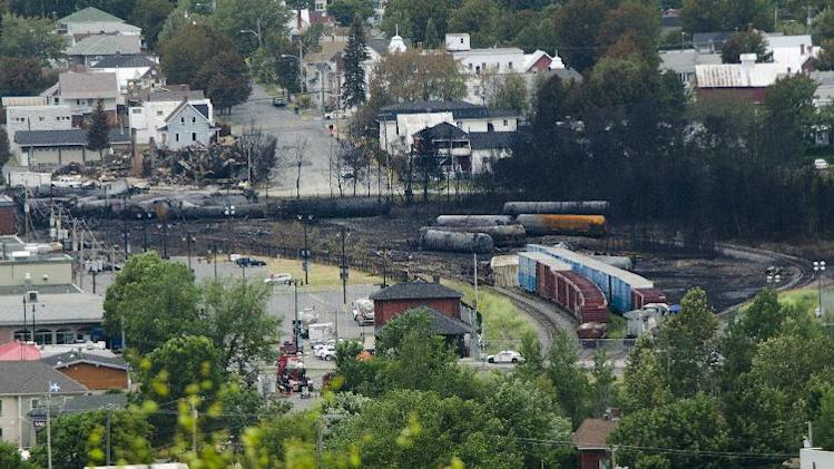 Scorched oil tankers remain on July 10, 2013 at the train derailment site in Lac-Megantic, Quebec