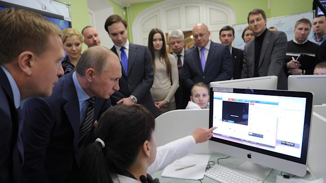 Russian Prime Minister Vladimir Putin, second left, visits the election monitoring center in Moscow, Tuesday, March 6, 2012. Putin won his third presidential term in Sunday's election. (AP Photo/RIA-Novosti, Yana Lapikova, Government Press Service)