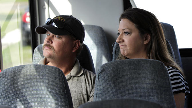 Bobby and Christine Norman, of Mechanicsville, Va., react as their tour van passes a blighted home in the Upper 9th Ward section of New Orleans, Tuesday, Oct. 2, 2012. Residents and the City of New Orleans may be pushing back against tour companies ushering out-of-towners into to the Lower 9th Ward, the neighborhood made famous when floodwalls and levees failed in 2005, pushing homes off their foundations and stranding residents on rooftops. (AP Photo/Gerald Herbert)