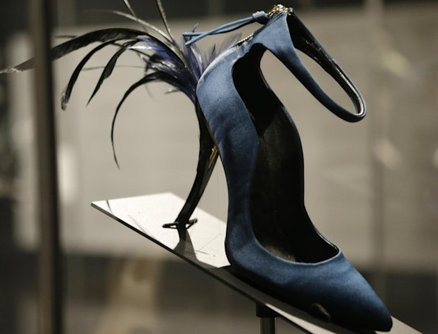 This Feb. 11, 2013 photo shows Roger Vivier's Eyelash Heel pump displayed at the &quot;Shoe Obsession&quot; exhibit at The Museum at the Fashion Institute of Technology Museum in New York. The exhibition, showi