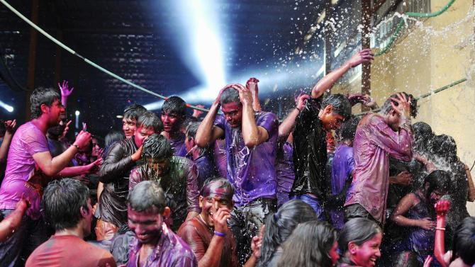 People are drenched with water as they celebrate Holi in southern Indian city of Bengaluru