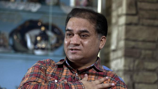 Ilham Tohti at his home in Beijing