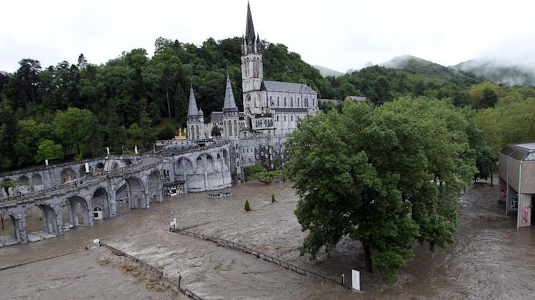 The sanctuary of Lourdes flooded, in Lourdes, southwestern France, Tuesday, June 18, 2013. French rescue services and police are evacuating hundreds of pilgrims from hotels threatened by floodwaters from a rain-swollen river in the Roman Catholic shrine town of Lourdes. (AP Photo/Bob Edme)