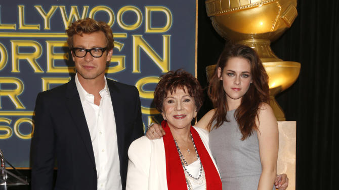 Simon Baker, HFPA President Dr. Aida Takla-O'Reilly and Kristen Stewart announce Jodie Foster as the recipient of the Cecil B. DeMille Award which will be honored at the 70th Annual Golden Globe® Awards Thursday Nov. 1, 2012 in Beverly Hills, Calif.  (Photo by Todd Williamson/Invision/AP Images)