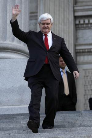 Republican presidential candidate former, House Speaker Newt Gingrich waves as he arrives at a rally for home ownership, Thursday, Jan. 12, 2012, at the State Capitol in Columbia, S.C. (AP Photo/Matt Rourke)