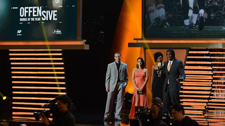 From left, Drew Brees of New Orleans Saints, Actress Olivia Munn and Robert Griffin III of the Washington Redskins at the 2nd Annual NFL Honors on Saturday, Feb. 2, 2013 in New Orleans. (Photo by Jordan Strauss/Invision/AP)