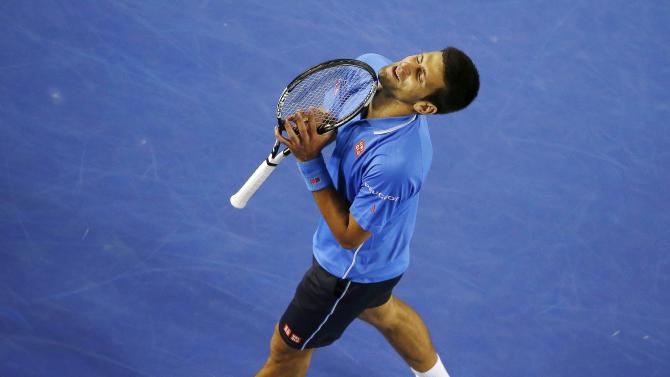 Djokovic of Serbia reacts after missing a shot against Muller of Luxembourg during their men's singles match at the Australian Open 2015 tennis tournament in Melbourne