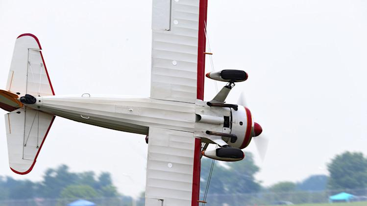A stunt plane loses control as a wing walker performs at the Vectren Air Show just before crashing, Saturday, June 22, 2013, in Dayton, Ohio. The crash killed the pilot and the stunt walker instantly, authorities said. (AP Photo/Thanh V Tran)
