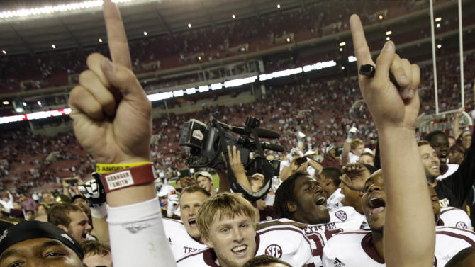 Texas A&M quarterback Johnny Manziel (2) celebrates after the Aggies defeated top-ranked Alabama 29-24  in an NCAA college football game at Bryant-Denny Stadium in Tuscaloosa, Ala., Saturday, Nov. 10, 2012. (AP Photo/Dave Martin)