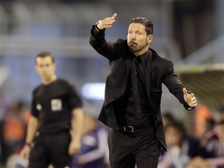 Atletico Madrid's coach Diego Pablo Simeone gestures during their Spanish first division soccer match against Celta Vigo at the Balaidos stadium in Vigo