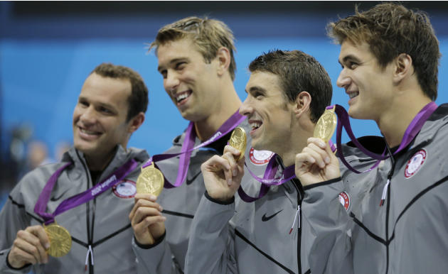 United States' men's 4 X 100-meter medley relay team from left, Brendan Hansen, Matthew Grevers, Michael Phelps and Nathan Adrian hold their gold medals at the Aquatics Centre in the Olympic Park duri