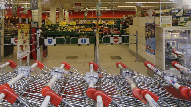 An empty market in Milan , Italy, Wednesday, May 15, 2013. The recession across the economy of the 17 European Union countries that use the euro extended into its sixth quarter longer than the calamitous slump that hit the region in the financial crisis of 2008-9. (AP Photo/Luca Bruno)