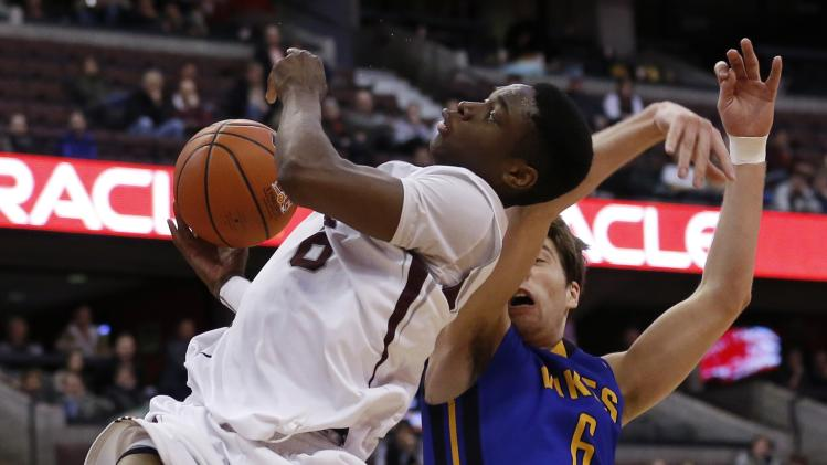 University of Ottawa Gee-Gees' Agada goes to the basket against University of Victoria Vikes' Roth during their CIS semi-final basketball game in Ottawa