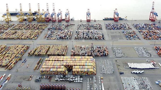 Cars and containers are pictured at a shipping terminal in the harbour of the German northern town of Bremerhaven