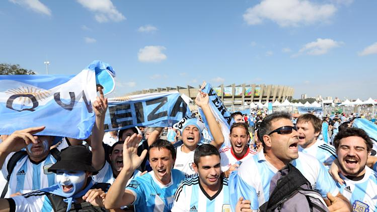 Argentina fans cheer as they arrive for the group F World Cup soccer match between Argentina and Iran at the Mineirao Stadium in Belo Horizonte, Brazil, Saturday, June 21, 2014. (AP Photo/Jon Super)