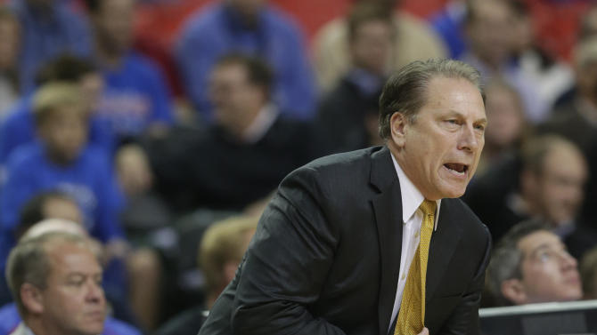 Michigan State coach Tom Izzo reacts during the first half of an NCAA college basketball game against Kansas at the Georgia Dome in Atlanta Tuesday, Nov. 13, 2012. (AP Photo/Dave Martin)