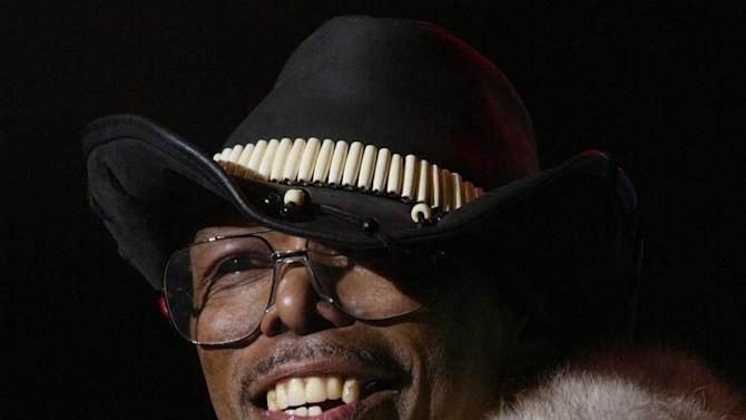 """In a 2002 photo, Leroy """"Sugarfoot"""" Bonner, lead singer for the Ohio Players, performs during day two of the Midtown Music Festival in Atlanta. Bonner, frontman for the hit-making funk music band the Ohio Players, died Saturday, Jan. 26, 2013 in southwest Ohio. He was 69. (AP Photo/Atlanta Journal-Constitution, Michael McCarter) MARIETTA DAILY OUT; GWINNETT DAILY POST OUT; LOCAL TV OUT; WXIA-TV OUT; WGCL-TV OUT"""