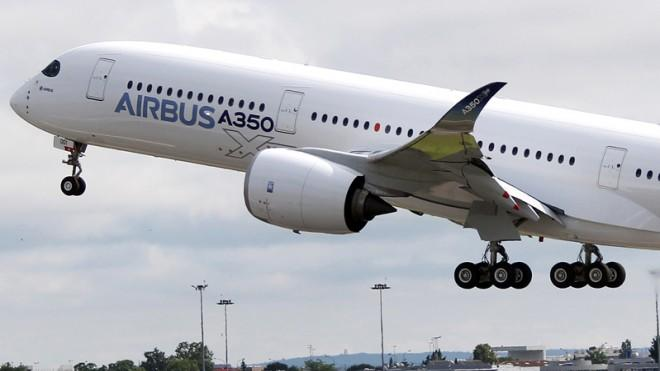 The Airbus A350 takes off on its maiden flight at Blagnac airport in southwestern France, June 14.