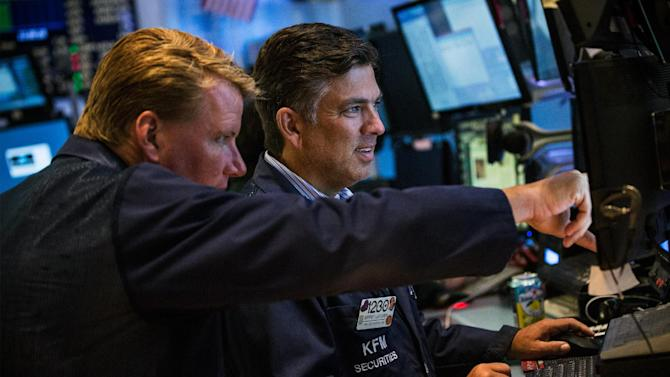 Traders work on the floor of the New York Stock Exchange on July 3, 2014 in New York City